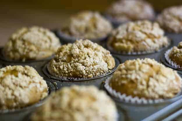 Pumpkin muffins cooked in a muffin pan.