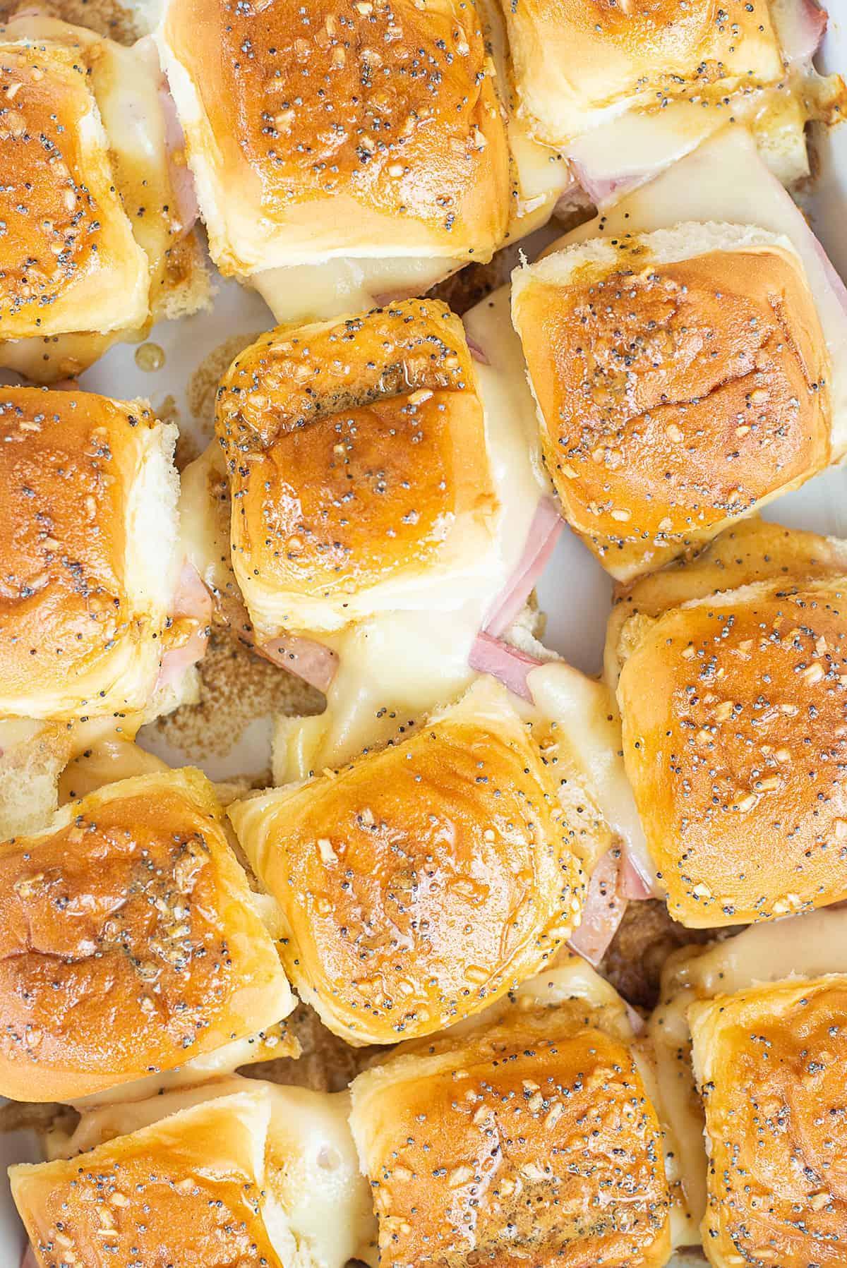 Hawaiian roll ham and cheese sliders in baking dish.