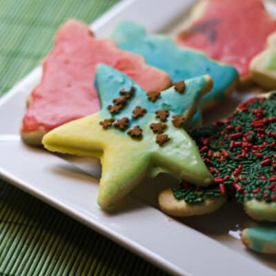 A square plate full of various Christmas cookies