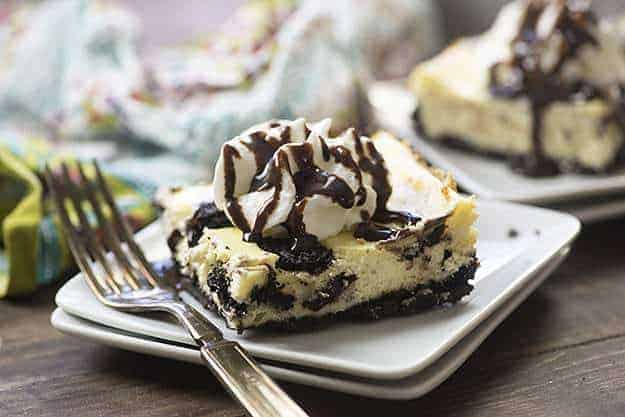 This Oreo cheesecake recipe has just a handful of ingredients! We love the Oreo cookie crust hiding under the creamy cheesecake!