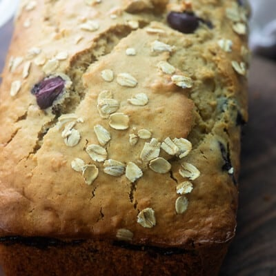 Close up of oatmeal bread on a cutting board.