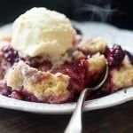 This blackberry cobbler recipe has quickly become our favorite way to make cobbler! The dough on top of the berries is just amazing!