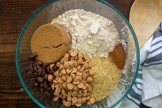 ingredients for granola bars in glass bowl.