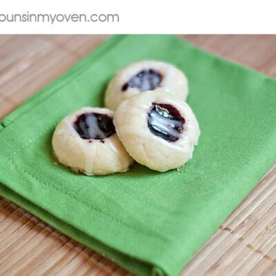 three thumb print cookies on a cloth napkin