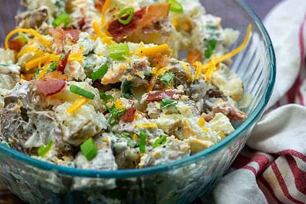 baked potato salad in glass bowl.