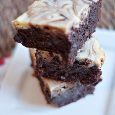 Three stacked cheesecake brownies