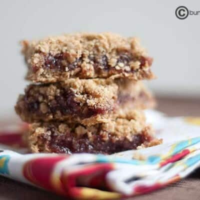 Three stacked raspberry oatmeal bars