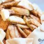 A closeup of apple slices in a pie crust