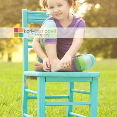 A little girl sitting on a chair