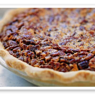A close up of chocolate pecan pie.