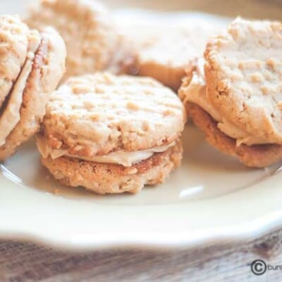 Peanut butter sandwich cookies on a plate.