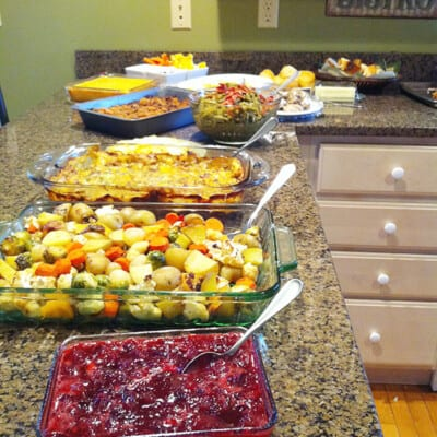 A large spread of various foods for a holiday get together.