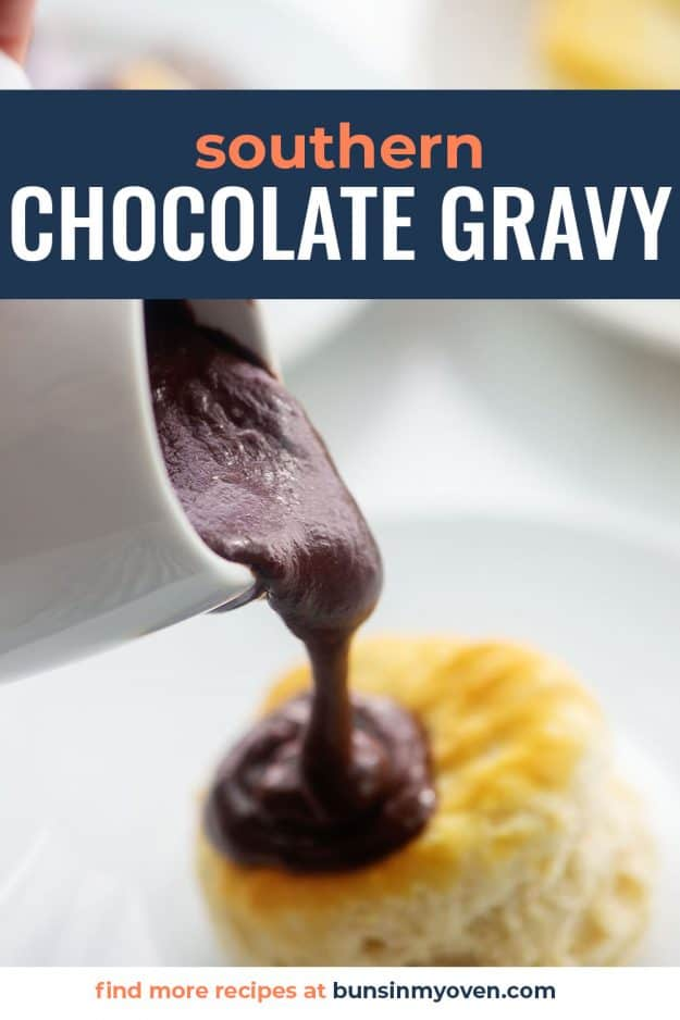 biscuit with gravy being poured over the top.