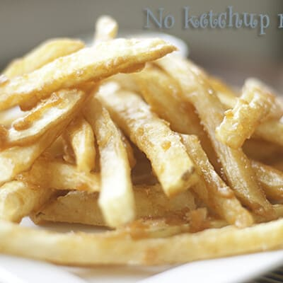 A closeup of battered French fries