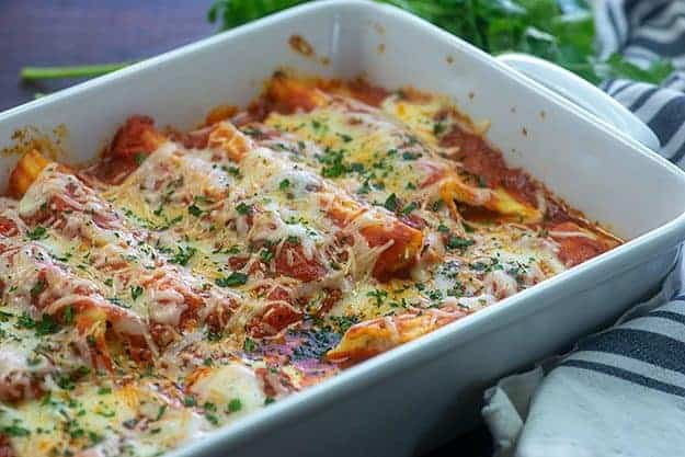 baked manicotti in white baking dish