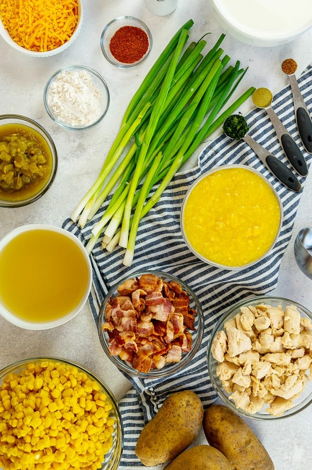 ingredients for corn and chicken chowder on countertop.