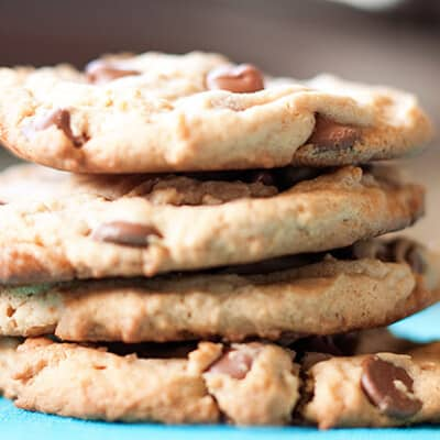 A stack of peanut butter chocolate chip cookies up close