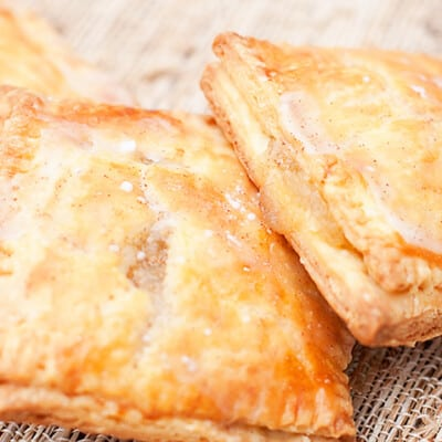 A close up of two homemade apple poptarts