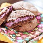 A closeup of raspberry cheesecake stuffed cookies on a napkin