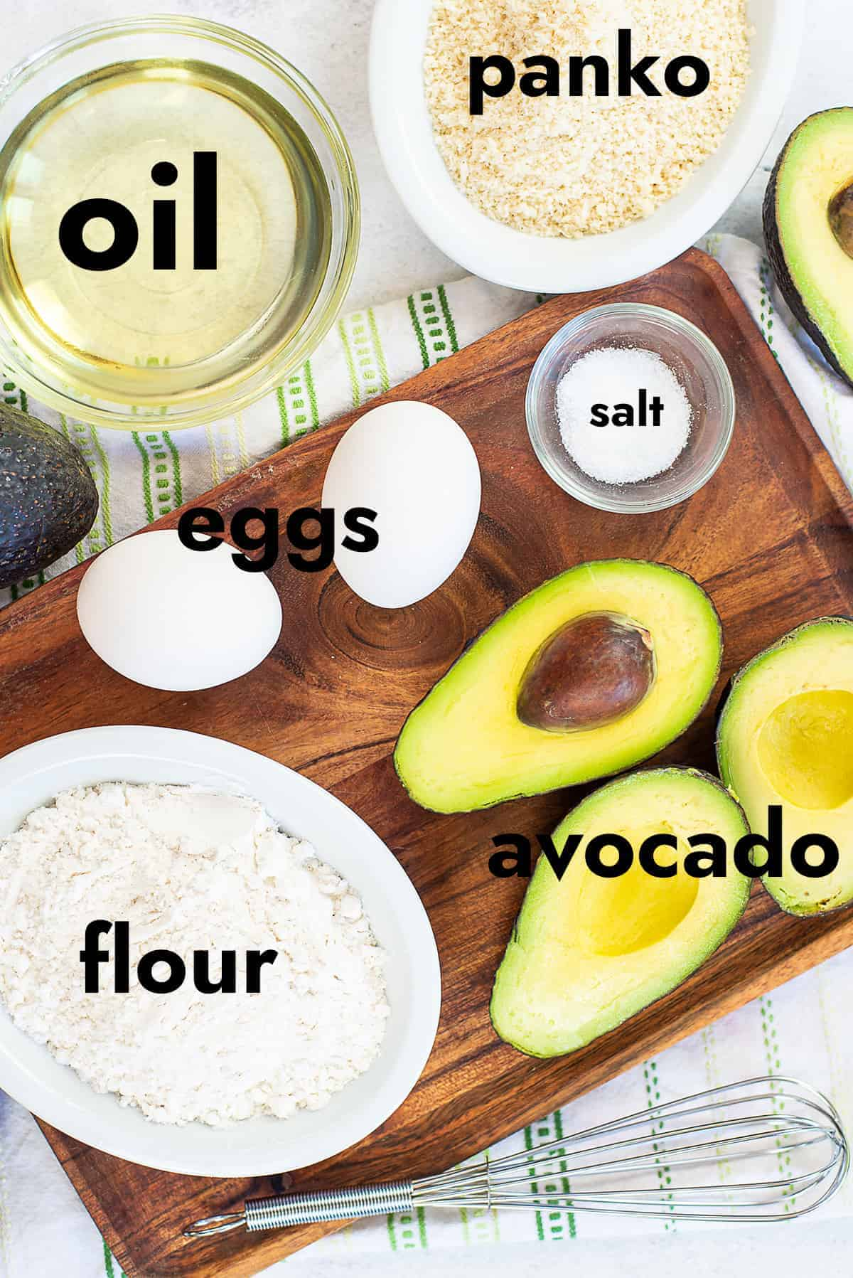 ingredients for avocado fries on wooden board.