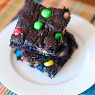 Stacked up brownies with M&M's in them.