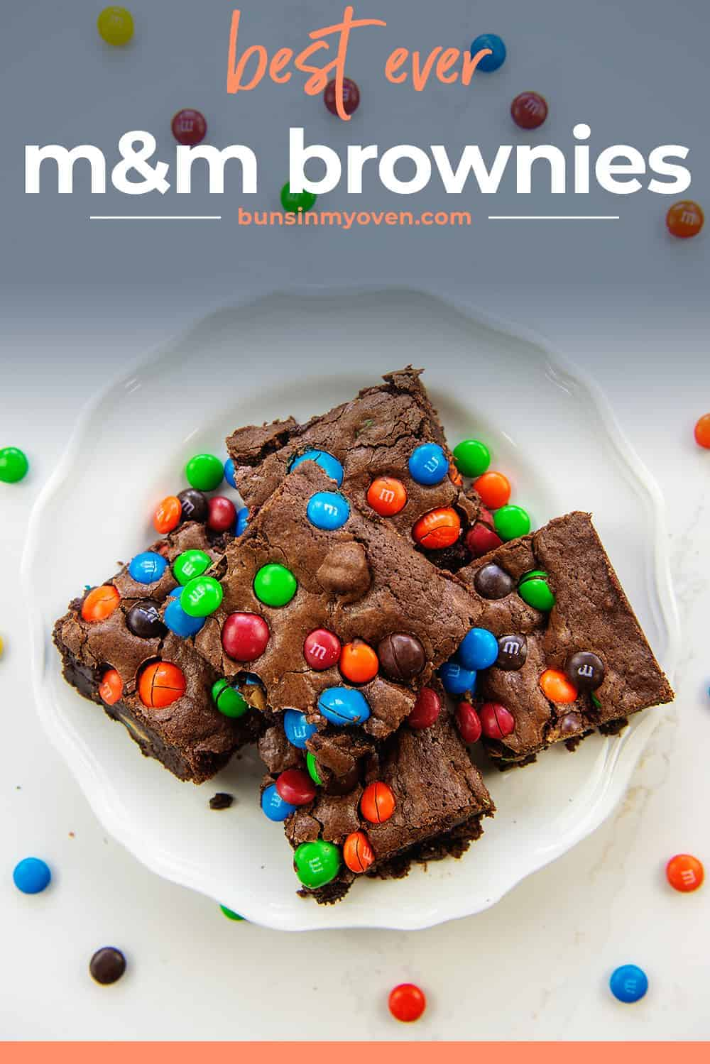 plate of brownies with m&m candies.