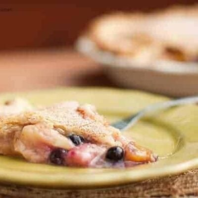 A close up of peach blueberry pie