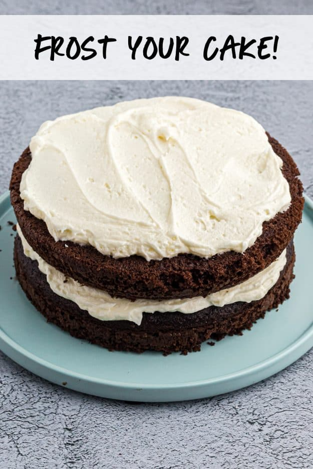 chocolate layer cake with frosting on top.