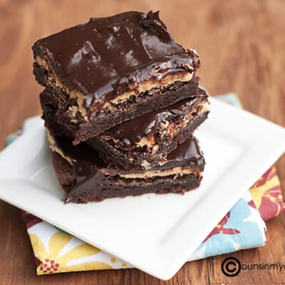 A stack of buckeye brownies on a square plate.