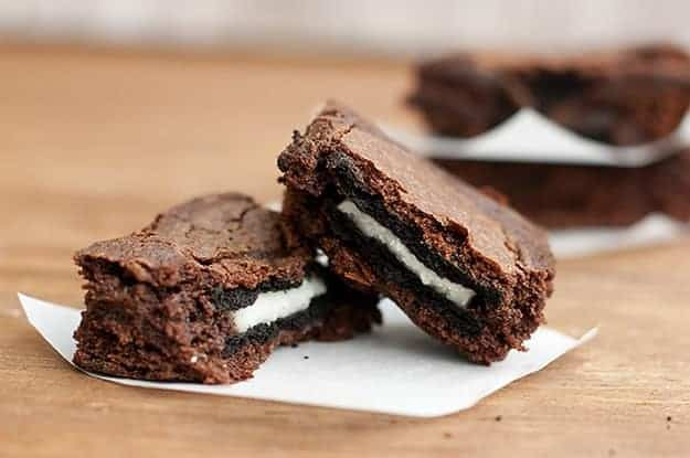 Oreo cookie brownies split in two.