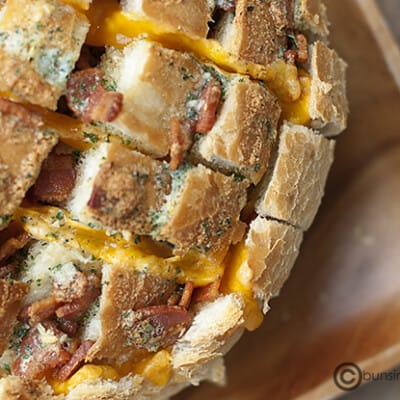 A close up of cheese and bacon bread.
