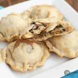 A plate of mini chocolate chip pies.