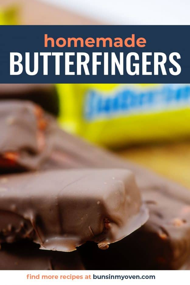Butterfinger candy bars piled on cutting board.