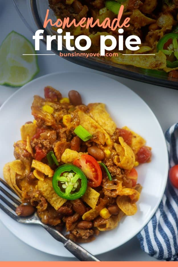 overhead view of Tex-Mex frito chili pie on white plate.