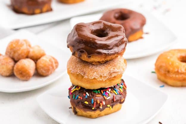 stack of canned biscuit donuts on white plate.