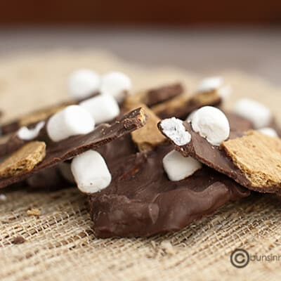 Smores bark pieces on a woven placemat.