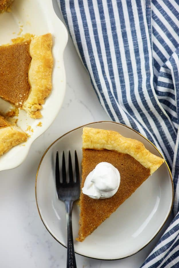 southern sweet potato pie recipe on white plate.