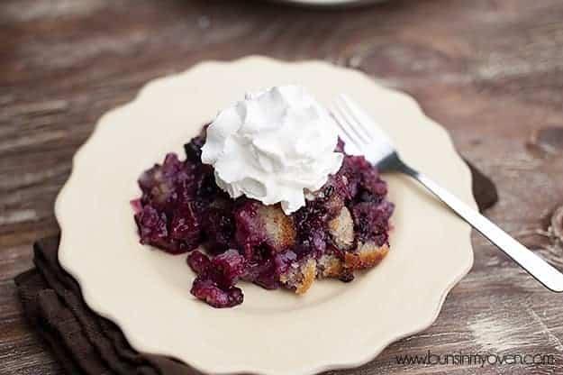 Whipped cream on top of blackberry cobbler