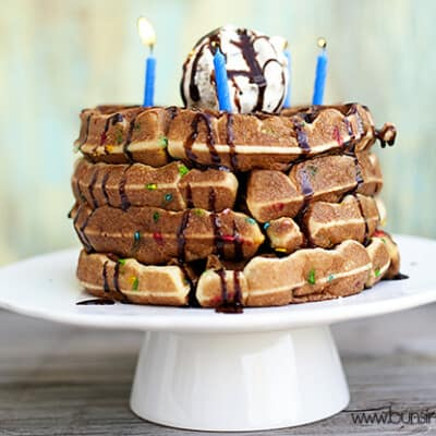 A closeup of waffles with birthday candles on them