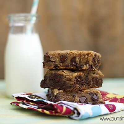 A stack of cookie bars on a folded cloth napkin