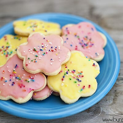 A plateful of iced cookies with sprinkles on top