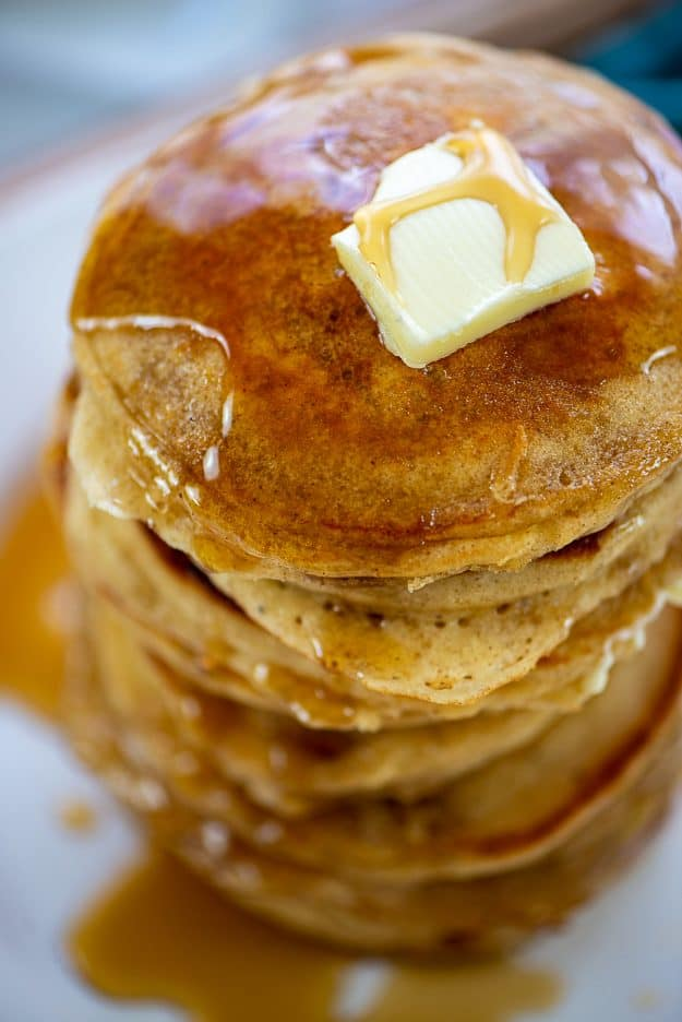 stack of pancakes with butter and syrup on top.