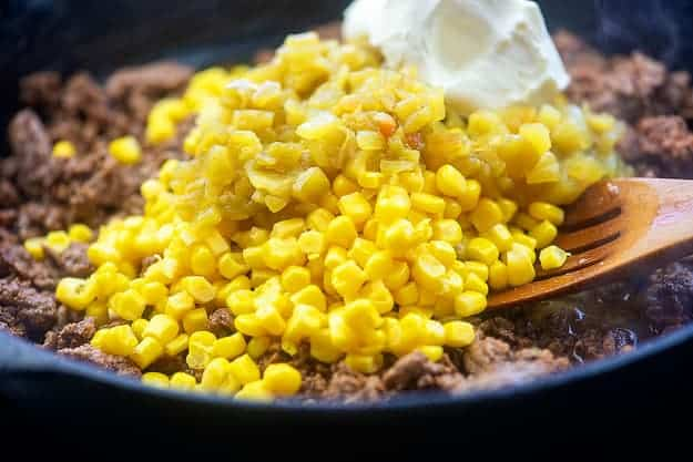 ground beef in skillet with corn and cream cheese