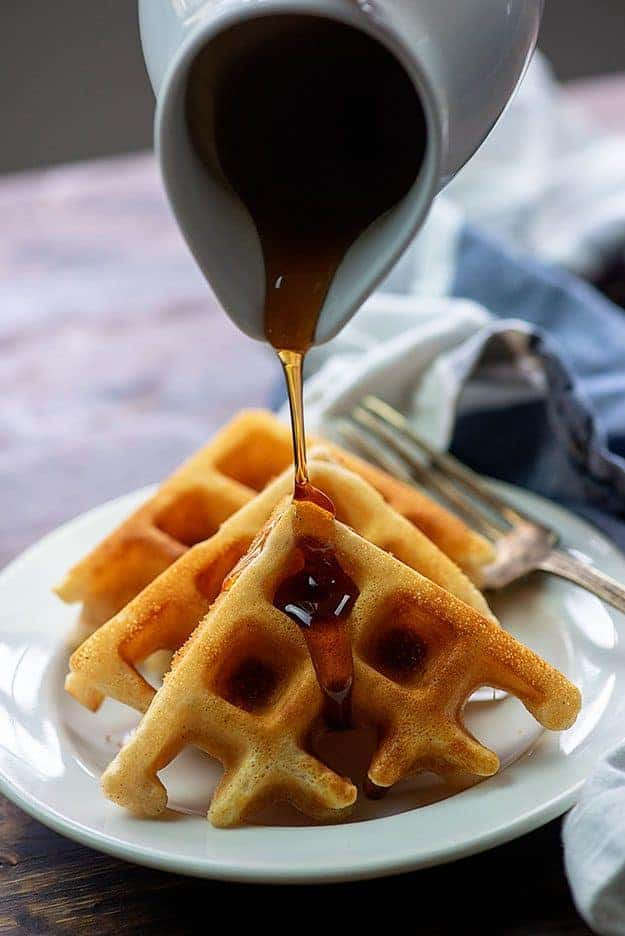 syrup pouring over belgian waffles