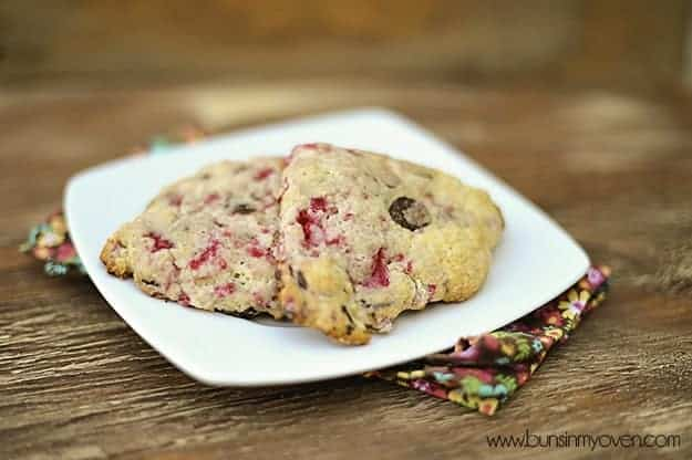 Two chocolate raspberry scones on a square plate