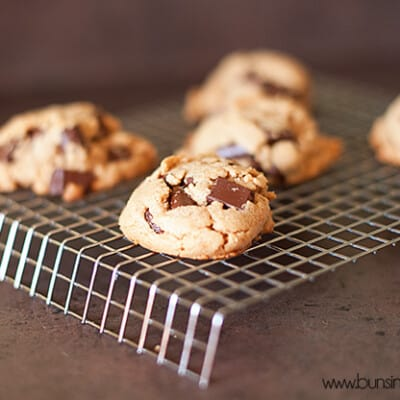 Peanut butter and chocolate chip cookies on a wire cooling rack
