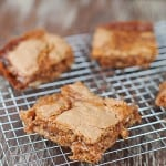 A few cinnamon caramel bars on a wire cooling rack