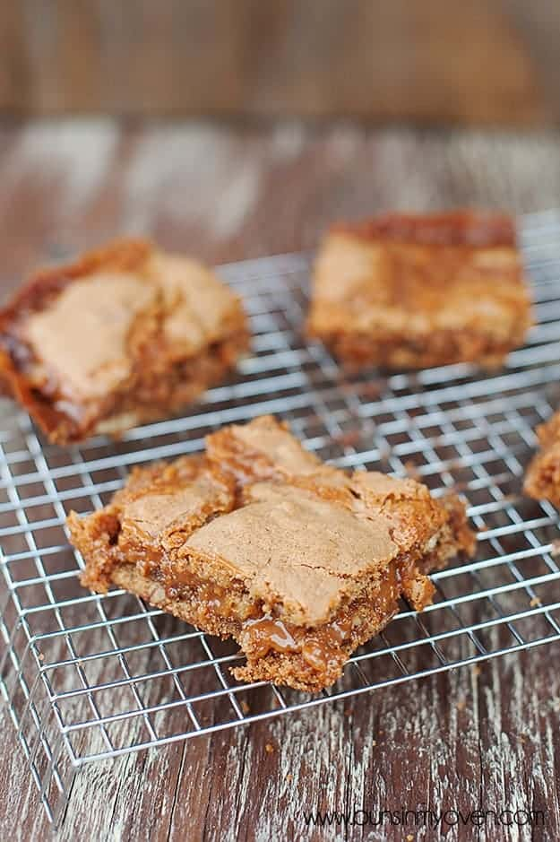 Four caramel cinnamon bars on a wire cooling rack