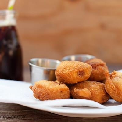 A plate of corn dog bites on a table