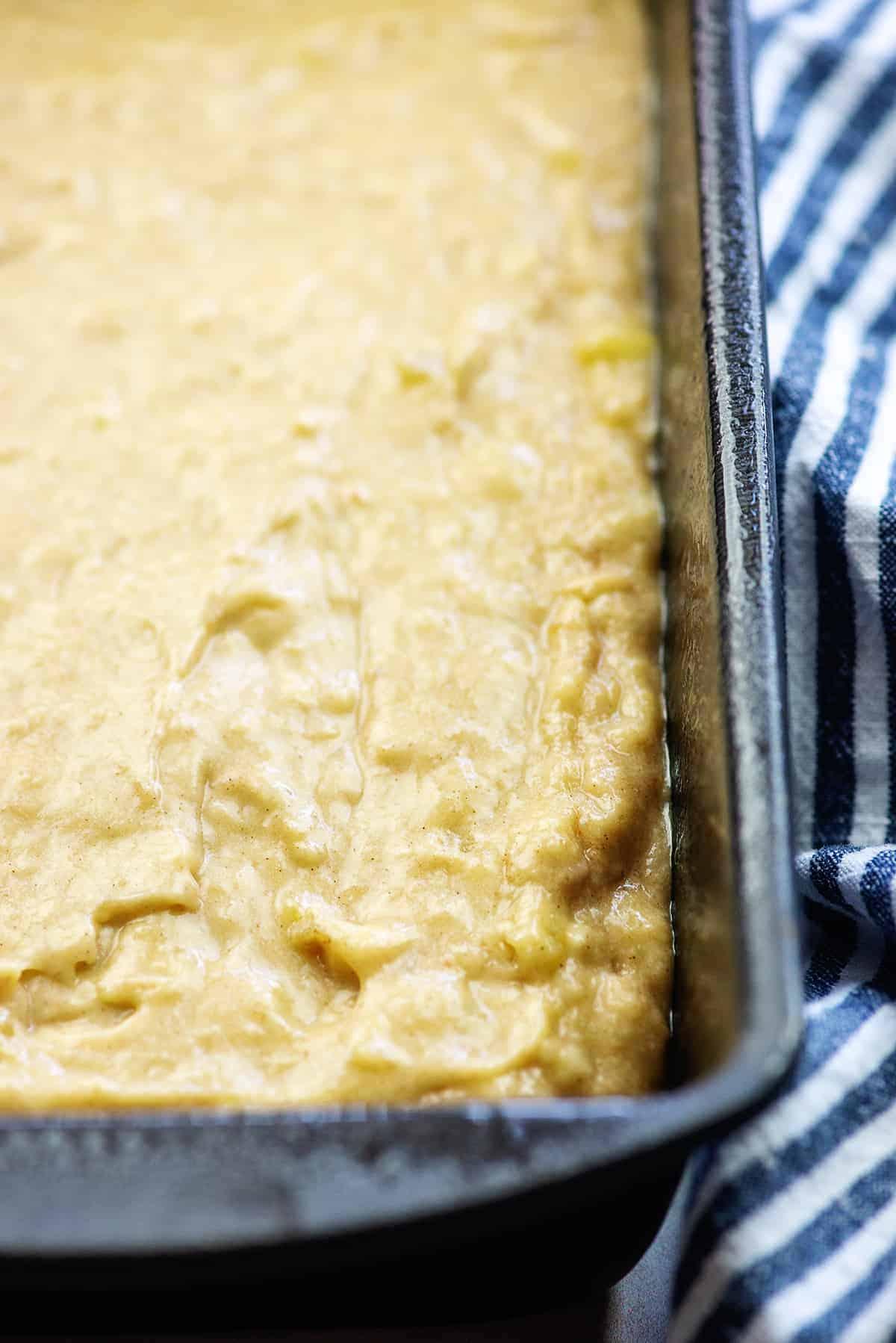 banana bread batter in metal loaf pan